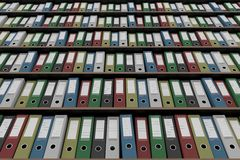 Multiple colorful office binders on shelves, part of the set. 3D rendering Royalty Free Stock Photos