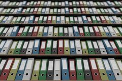 Multiple colorful office binders on shelves, part of the set. 3D rendering Royalty Free Stock Photography