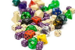 Multiple colorful role playing dices lying on  backgroun Royalty Free Stock Photos