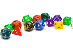 Multiple colorful role playing dices lying on  backgroun Stock Images