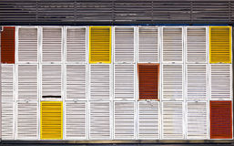 Multiple colors shutters. Composition of multiple colors shutters in a building Royalty Free Stock Photos