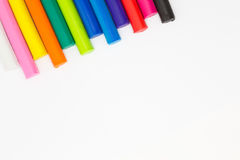 Multiple colour of clay sticks on top left conner white background Stock Photos