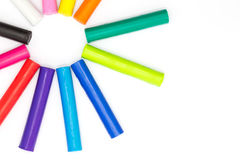Multiple colour of clay sticks on top left conner white backgroundMultiple colour of clay sticks on white background Royalty Free Stock Image