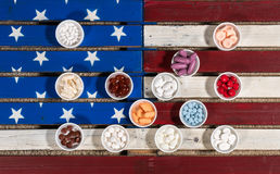 Multiple containers of prescription drugs on USA flag Royalty Free Stock Photos