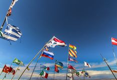 Multiple country flags against the wind at Plaza de las Banderas Uyuni stock photo