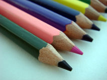 Multiple crayons pencil line up. Multiple colorful crayons pencil line up Royalty Free Stock Photos