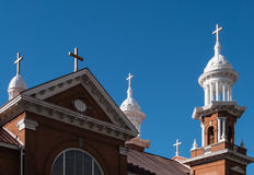 Multiple crosses on church rooftop Stock Photos