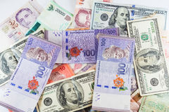 Multiple Currencies banknotes as colorful background Stock Photos