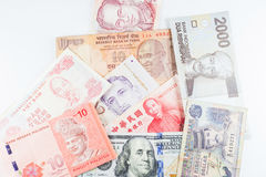 Multiple Currencies banknotes as colorful background Stock Image