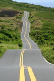 MULTIPLE CURVES IN THIS ROAD GOING UP A MOUNTAIN Stock Photo