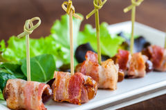 Multiple dates and bacon skewers. Stock Image