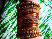 Multiple designs of Indian traditional jewelry. Picture of Multiple designs of Indian traditional jewelry made up of pure gold stock images