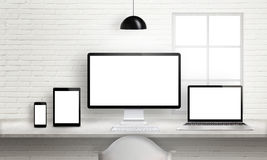 Multiple devices on office desk for responsive web site design presentation Stock Photography