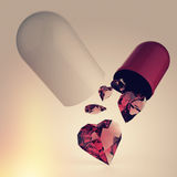 Multiple diamond hearts inside Capsule Pill Stock Images