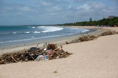 Disgusting and unsafe piles of rubbish on the beach in bali indonesia on 15th december 2018. Multiple disgusting and unsafe piles of rubbish on the beach in bali stock image