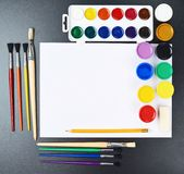 Multiple drawing paints and brushes Stock Image
