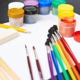 Multiple drawing paints and brushes Stock Photos