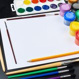 Multiple drawing paints and brushes Royalty Free Stock Photo