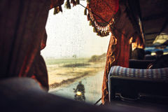 Multiple drops of water on a bus window, in the road to Phnom Pe Stock Image