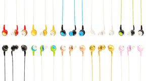 Multiple in-ear headphones Royalty Free Stock Photography