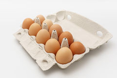 Multiple eggs in cardboard box on a white background. Multiple eggs in recycled cardboard box on a white background Royalty Free Stock Image