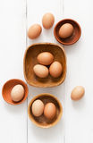 Multiple eggs in different bowls Stock Photography