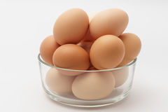 Multiple eggs in a glass bowl. Multiple eggs in a  glass bowl  on a white background Stock Photo