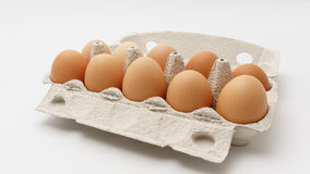 Multiple eggs in a paper package. On a white background Royalty Free Stock Image