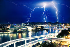 Multiple electric lightning strikes over river in Brisbane. Queensland, Australia royalty free stock photo