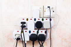 Multiple electricity plugs on adapter risk overloading and dange Royalty Free Stock Photography