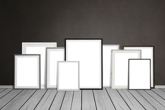 Multiple empty picture frames leaning on wall.  Royalty Free Stock Photos