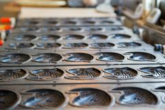 Multiple taiyaki molds in shop. Multiple empty Taiyaki molds on a stove at a shop. Kyushu, Japan. Travel and cuisine concept Stock Images