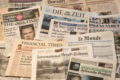 Multiple European newspapers in a pile. Front pages horisontal Stock Photo