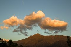 Fluffy yellow clouds over Iguaque mountain stock photo