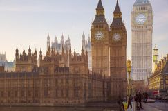 Multiple exposure image of beautiful morning on the Westminster bridge with blur of walking people. View include Big Ben and House Royalty Free Stock Photos