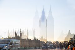 Multiple exposure image of beautiful morning on the Westminster bridge with blur of walking people. View include Big Ben and House Stock Image