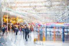 Multiple exposure image of lots of people walking and waiting for boarding in the Waterloo train station. Stock Photo