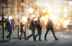 Multiple exposure image of walking people in London. Business concept illustration. Walking business people. Multiple exposure image. Business concept Stock Photography