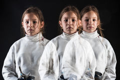 Multiple exposure of little girl in fencing costume Royalty Free Stock Photo