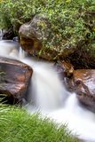 Thin waterfall runing down the mountain royalty free stock photo