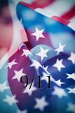 Text 9/11 for the September 11 attacks. Multiple exposures of different pictures of the flag of the United States of America, and the text 9/11 for the September royalty free stock photography