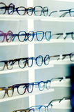 Multiple eyeglasses frames in optical store Stock Photography
