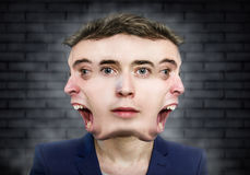 Multiple face man weird portrait over wall background Royalty Free Stock Photography