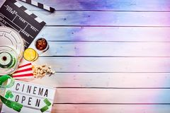 Multiple film reels and ticket rolls over wood Royalty Free Stock Photography