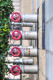 Multiple fire department connections on a  building wall Stock Photo