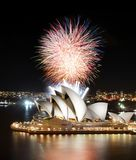 Multiple fireworks erupt above the Sydney Opera House in a fantastic semi-finale show. Sydney, Australia - March 8, 2018 - The semi-finale of a fireworks show royalty free stock photos