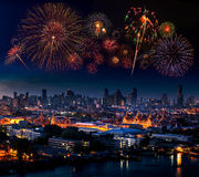 Multiple fireworks exploding high in the sky over Grand Palace,. Bangkok, Thailand stock images