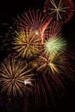 Multiple Fireworks Explosions. Multiple bursts of fireworks paint the night sky with beautiful colors Stock Photos