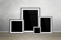 Multiple frames leaning on wall. Isolated for mockup.  Stock Photography