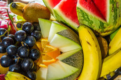 Multiple fruits on plate. Stock Images